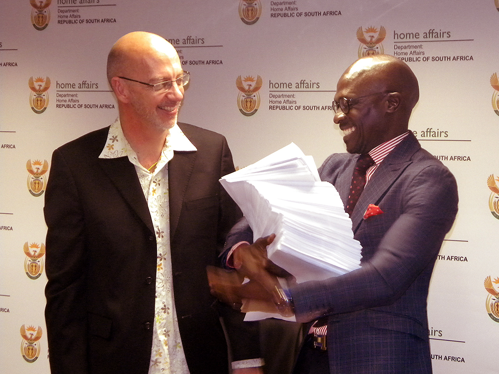 Partners deliver the signatures to Mr. Gigaba